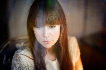 Sad red hair woman face portrait — Stockfoto
