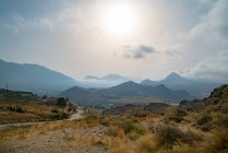 Mountainous landscape of Crete, sun in sky — Stock Photo