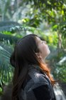 Young woman with closed eyes in nature — Stock Photo