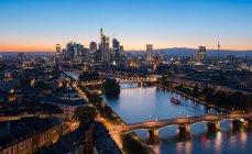Frankfurt nightlife, city view on river with bridges — Stock Photo