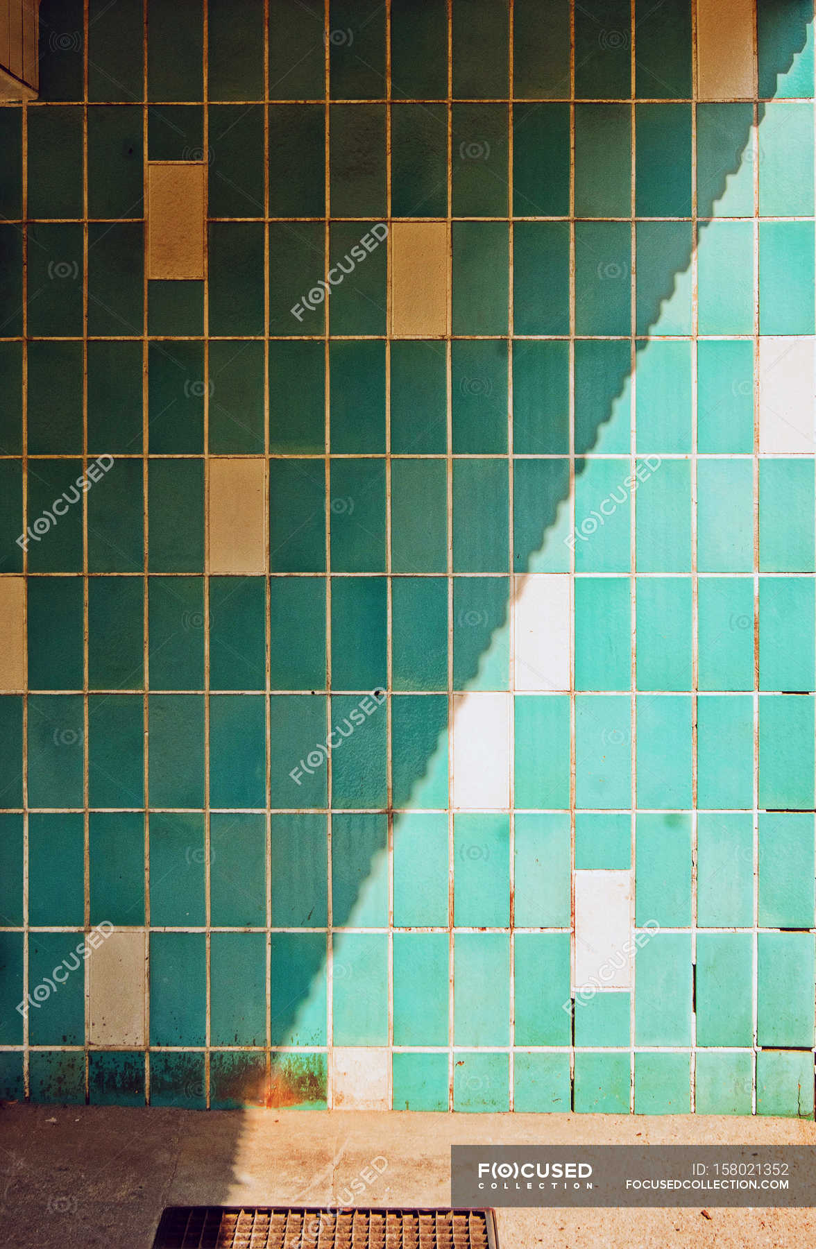 Sunshine and shadow over tiled wall — Stock Photo | #158021352