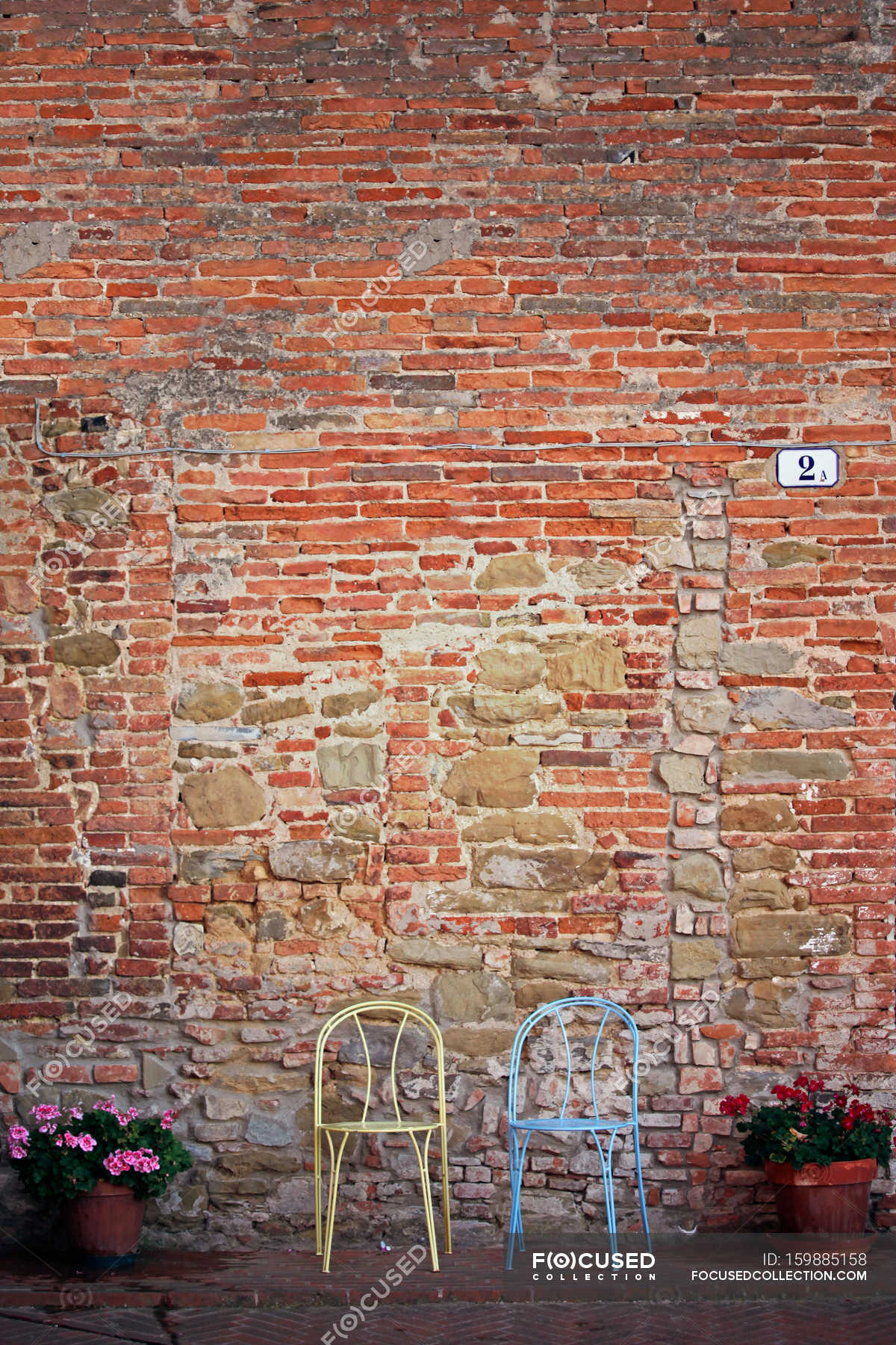 two chairs in front of brick wall stock photo 159885158