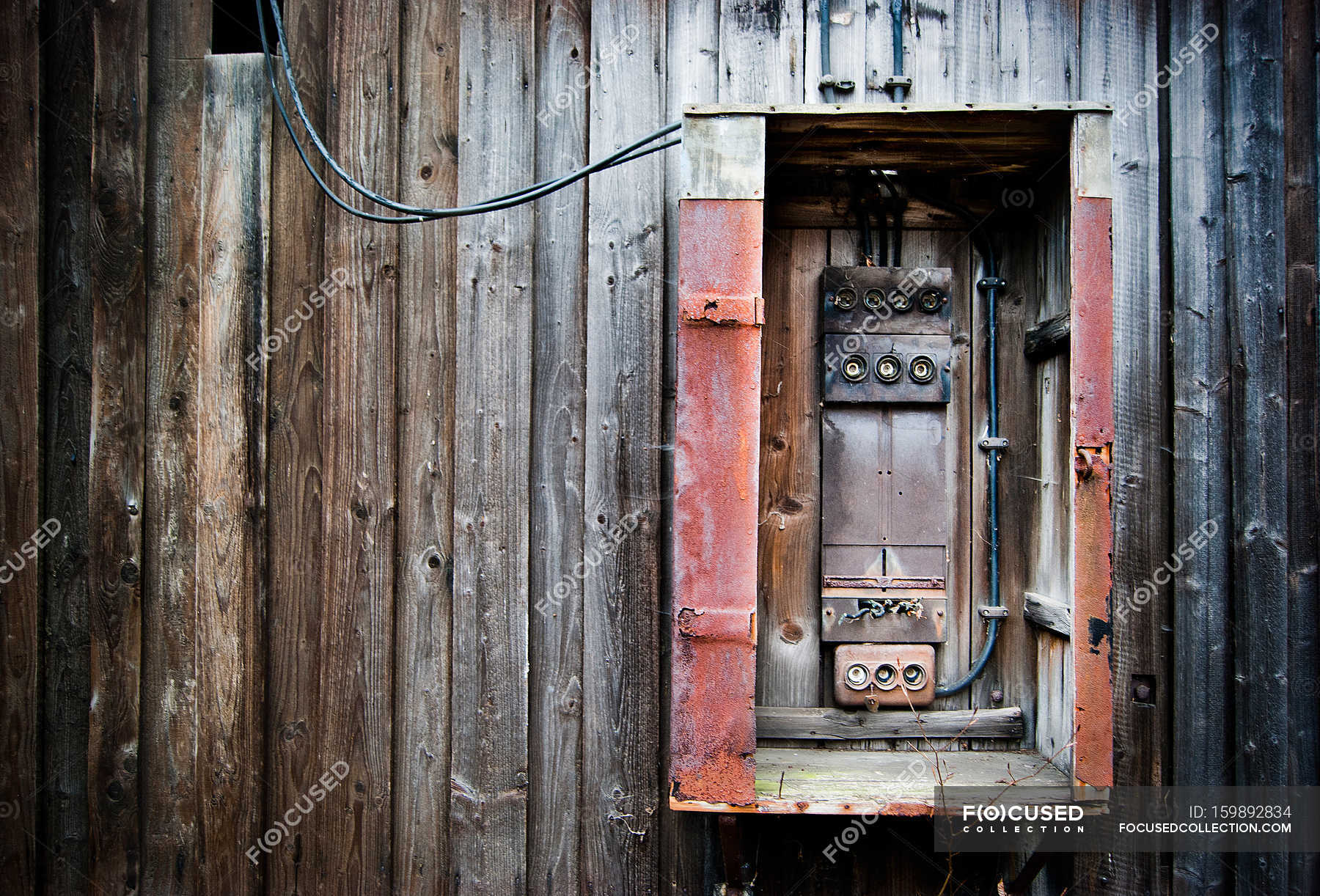wooden planks on wall of old house and fuse-box — stock photos