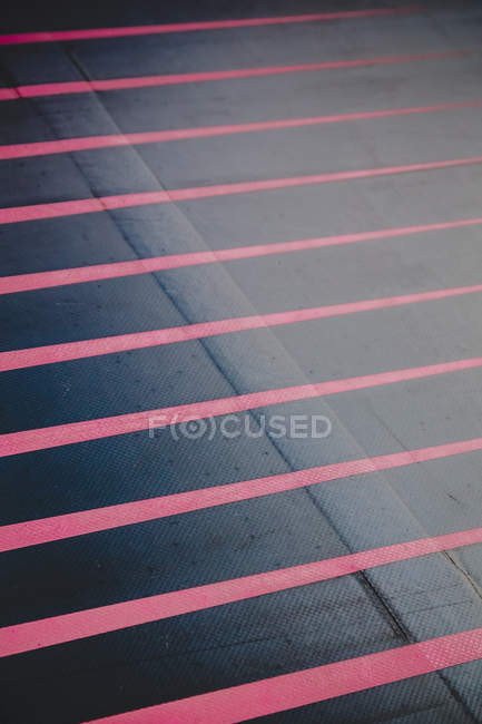 Gray floor cover with red stripes — Stock Photo