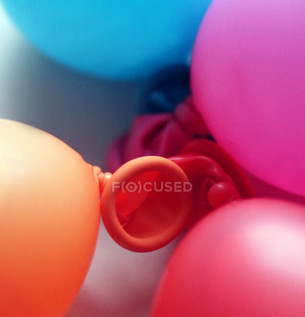 Colorful balloons on floor — Stock Photo