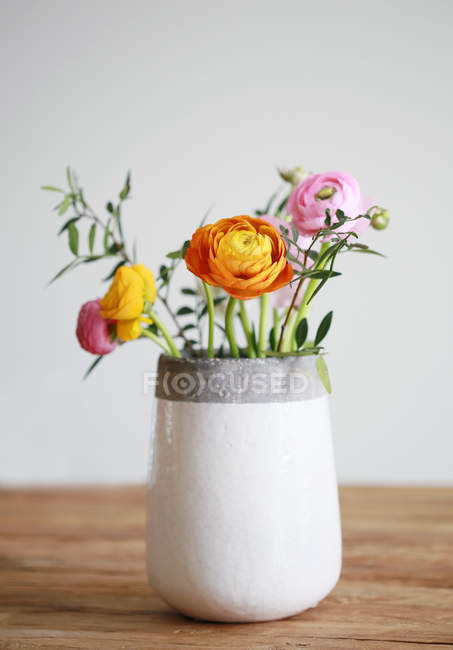 Colorful bouquet with buttercups in vase — Stock Photo