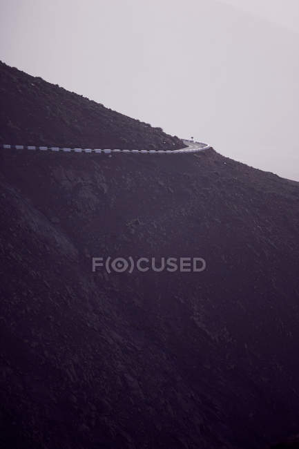 Road high in mountains at evening time — Stock Photo