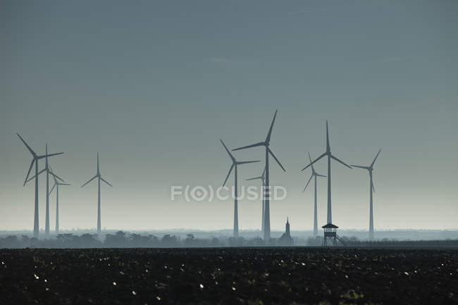 Wind mills in the field at night — Stock Photo