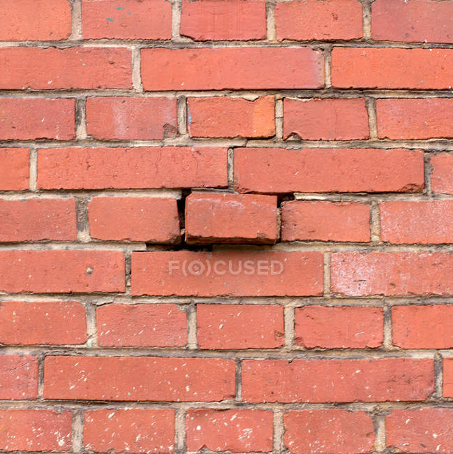 Bricks wall texture with one stuck out — Stock Photo