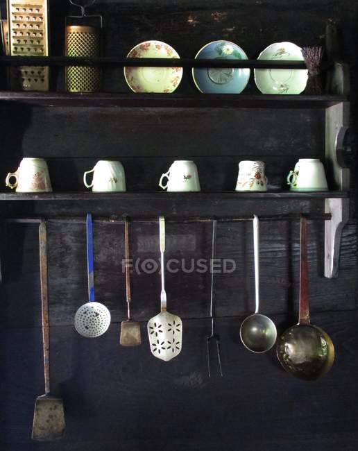 Front view of kitchenware and tableware in rustic cupboard — Stock Photo