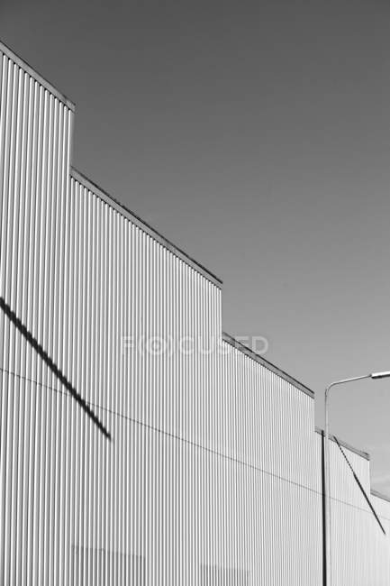 Daytime view of building wall in shape of stairs — Stock Photo