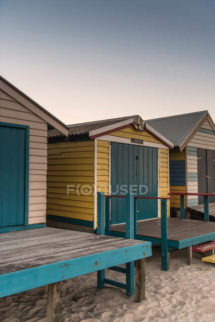 Daytime view of closed wooden beach huts — Stock Photo