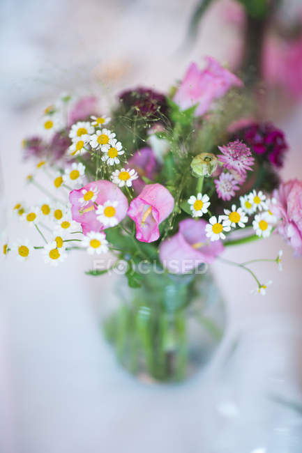 View of floral bouquet with bluebells and daisies — Stock Photo