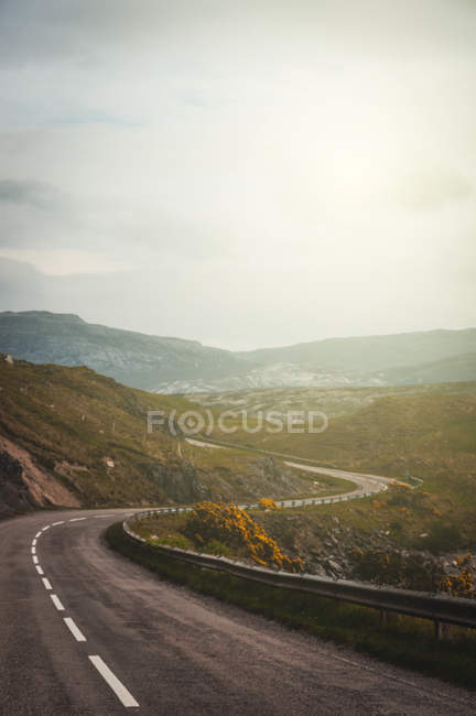 Curve speedway road in mountains — Stock Photo