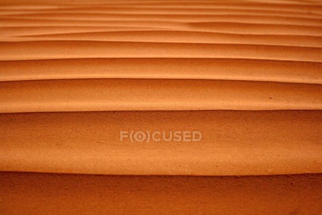 Bright orange desert sand surface — Stock Photo