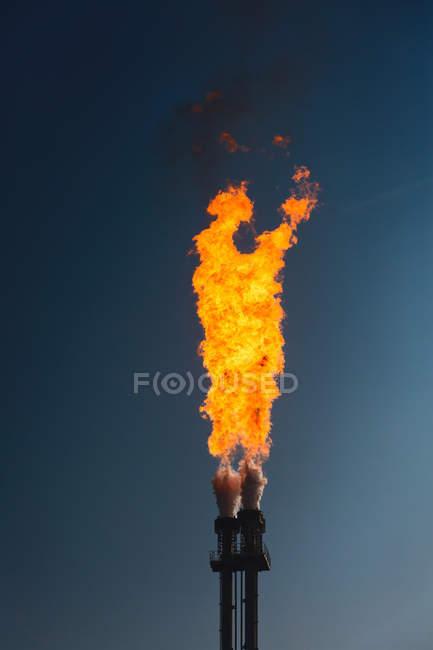 Environmental pollution concept, burning exhaust gas — Stock Photo