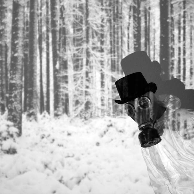 Daytime cropped view of person in gas mask and hat and winter forest — Stock Photo