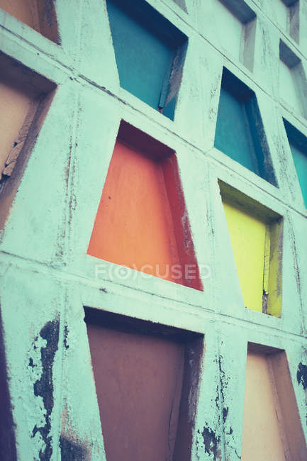 Partial view of concrete wall texture with colorful geometric shapes, minimalistic concept — Stock Photo
