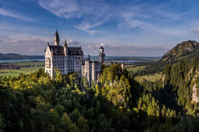 Neuschwanstein castle in the mountains — Stock Photo