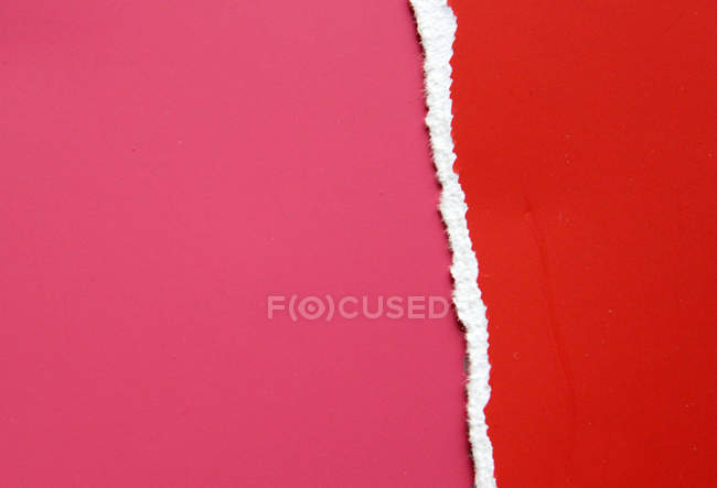 Close-up view of torn colorful paper — Stock Photo