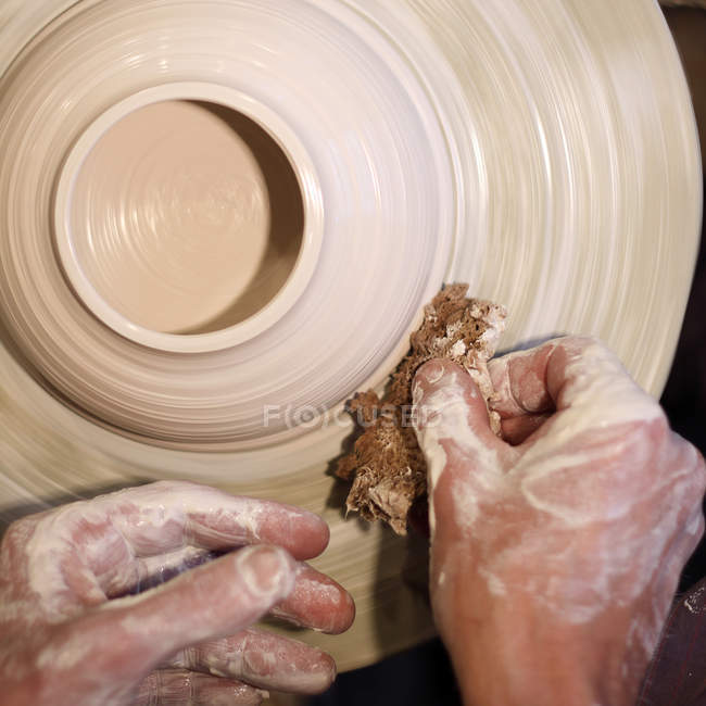 Craftsman hands working with clay — Stock Photo