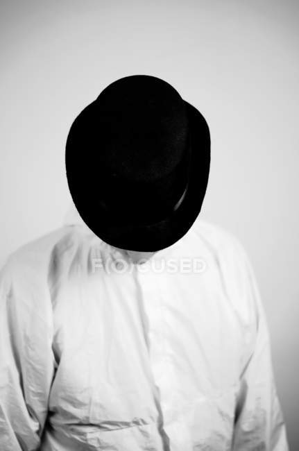 Front view of person in black hat and tilted head — Stock Photo