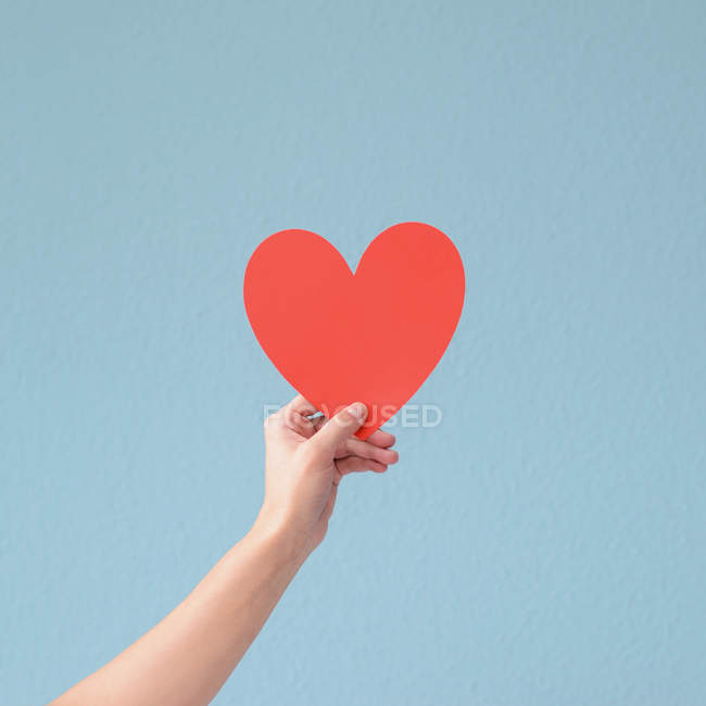 Close-up view of person holding paper heart — Stock Photo