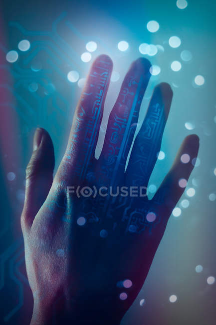 Cropped view of female hand lit with circuit board shaped pattern — Stock Photo
