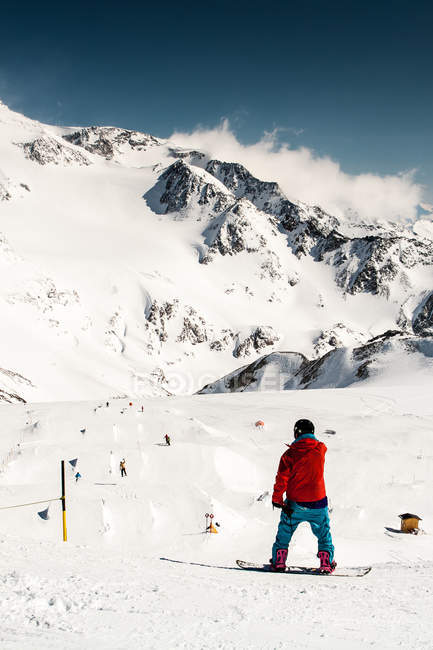 Mountains landscape and snowboarder — Stock Photo