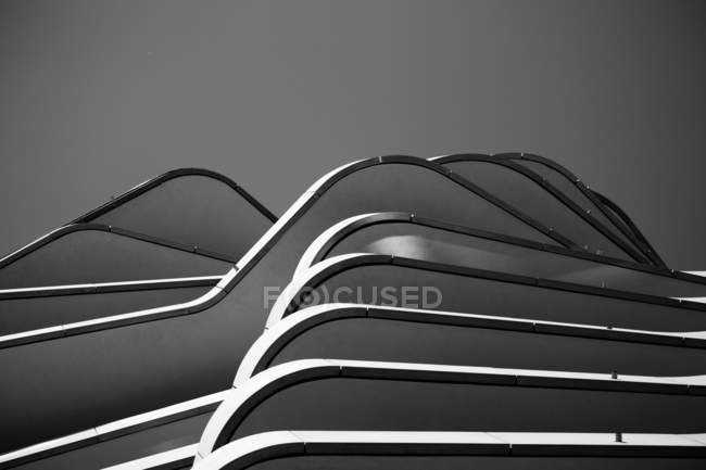 Exterior shot of white modern building facade, black and white — Stock Photo