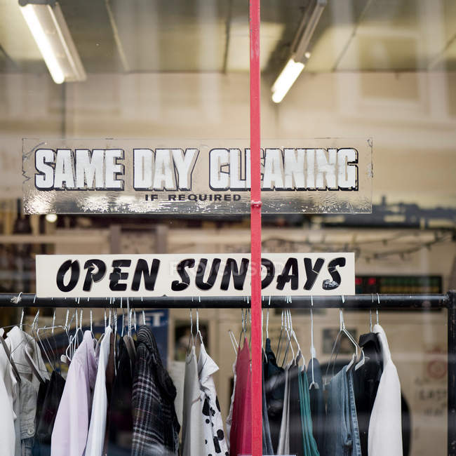 Announcement on the window of clothes cleaning service — Stock Photo