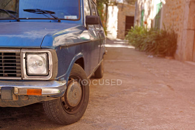 Closeup of retro car details in old town street — Stock Photo