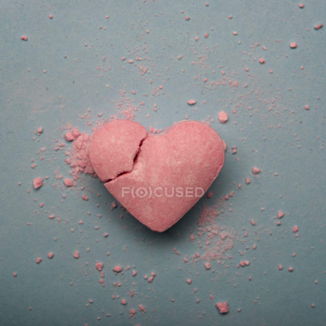 Broken heart shaped pink candy — Stock Photo