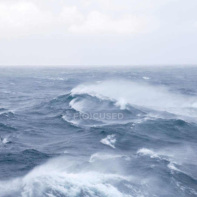 Ocean view with swirling waves — Stock Photo