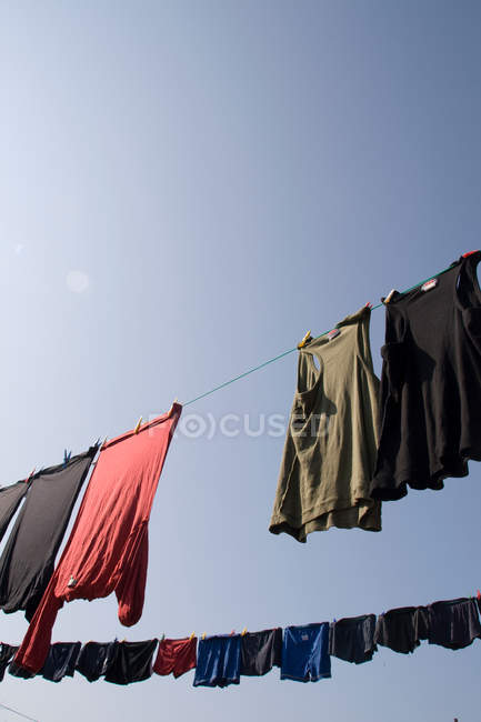 Clothesline with drying clothing bottom view — Stock Photo
