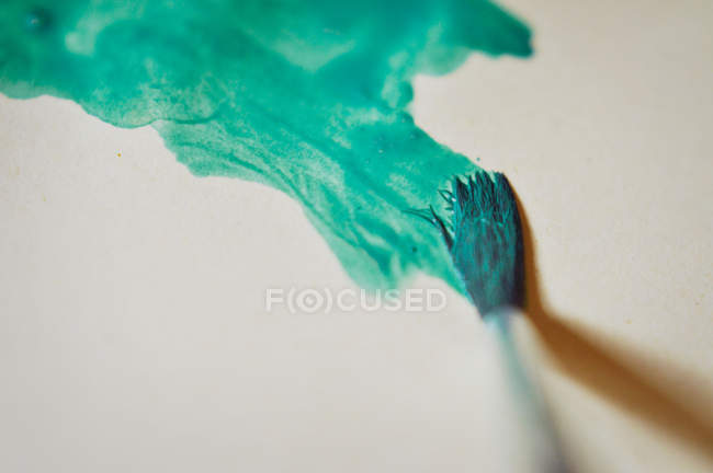 Colorful stroke of brushes on white canvas — Stock Photo