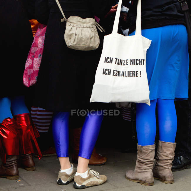 Rear cropped view of women in colorful clothes with bags, Cologne, Germany — Stock Photo