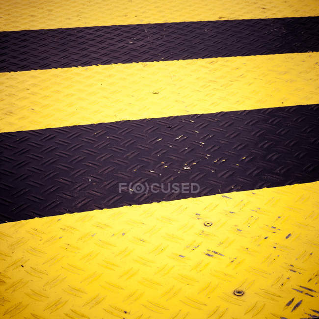 Yellow black stripes on floor covering — Stock Photo