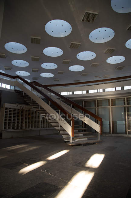 Interior with staircase and light beams on floor — Stock Photo