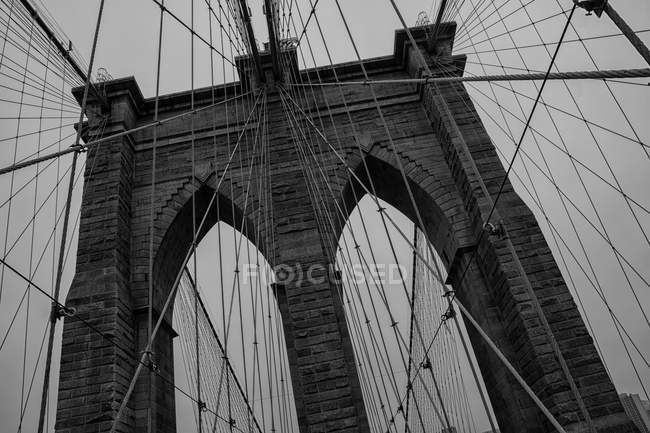 Daytime tilted view of Brooklyn suspension bridge in New York — Stock Photo