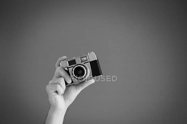 Close-up view of person hand holding camera — Stock Photo