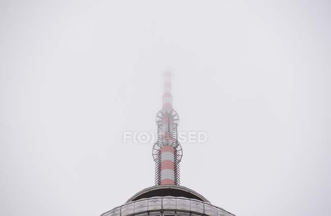 Daytime view of Berlin TV tower in fog — Stock Photo