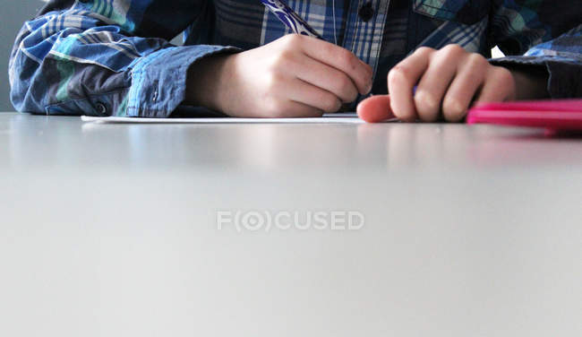 Close-up view of boy doing homework — Stock Photo