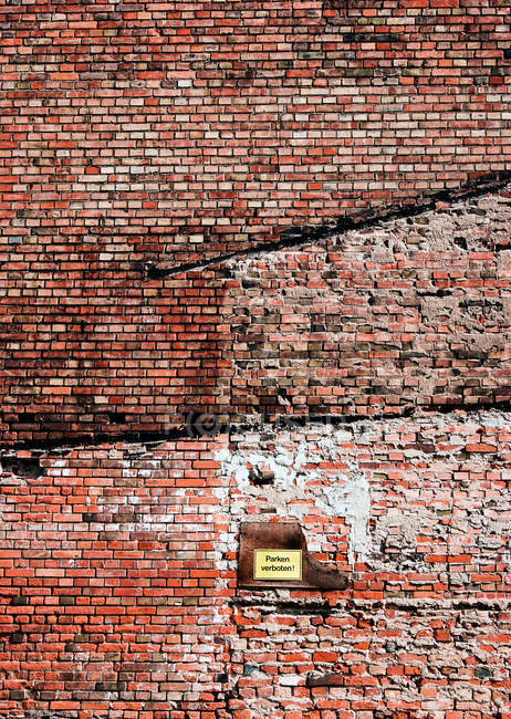 View of rough brick wall on street — Stock Photo