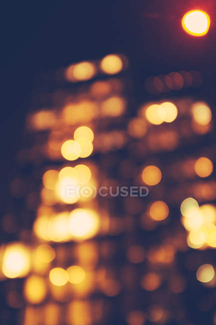 Abstract backdrop with blurred city lighting — Stock Photo