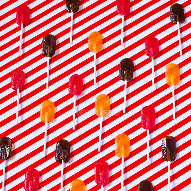 Lollipops composition on striped surface — Stock Photo