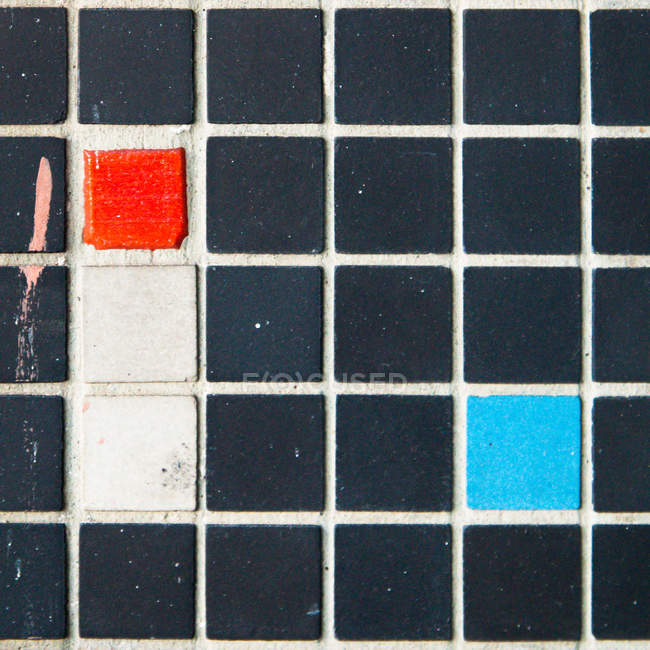 Abstract textured backdrop with colorful tile — Stock Photo