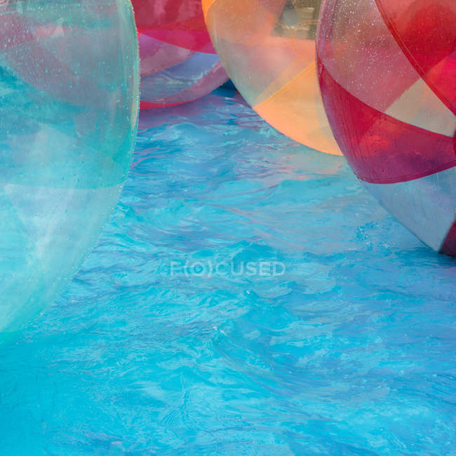 Swimming pool and floating colorful balls — Stock Photo