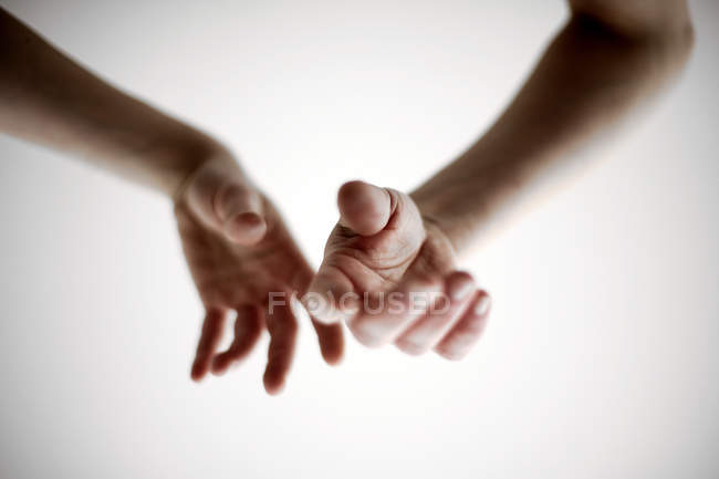 Cropped view of touching male and female hands — Stock Photo