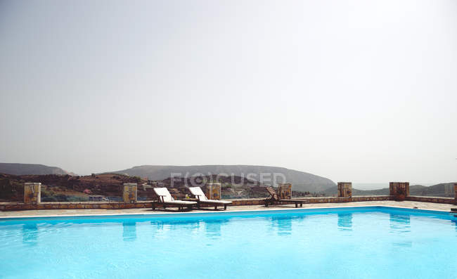 Swimming pool outdoors in mountains — Stock Photo